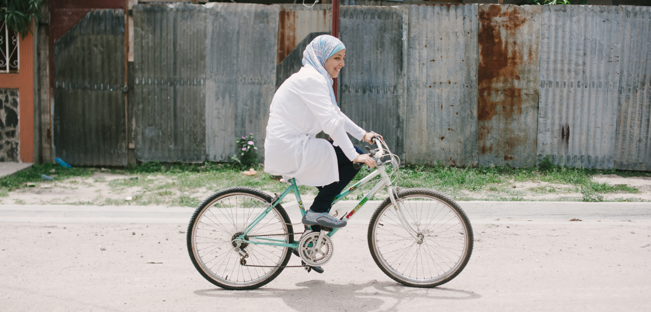 Sara Minkara riding a bicycle